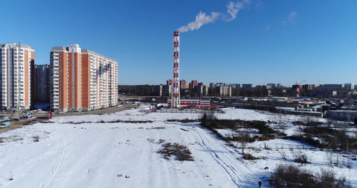 Chimney of power plant and multi-story houses Footage