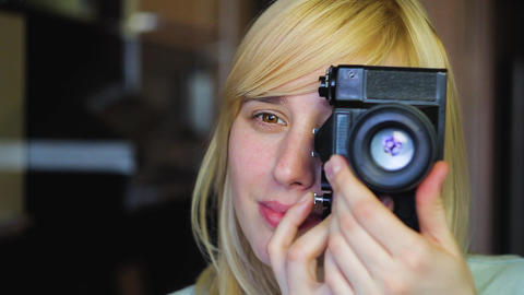 Blonde with different eyes shoots on an old retro camera, heterochromia Footage