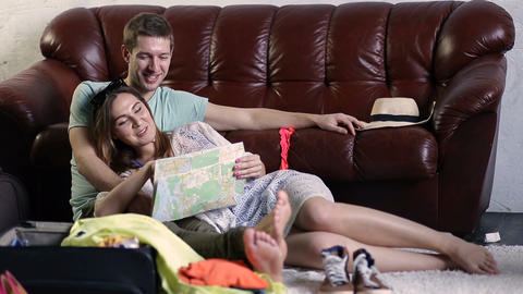 Happy young woman with paper map going on trip Live Action