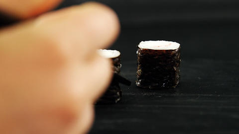 Maki sushi roll served on stone slate Live Action