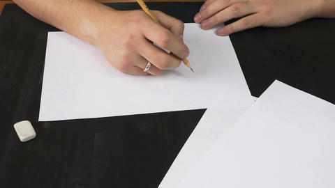 The artist draws a sketch of his product Live Action
