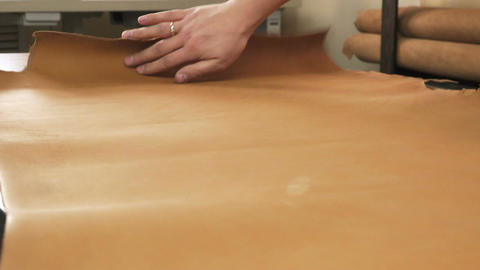 Man's hands transferring template to leather Footage