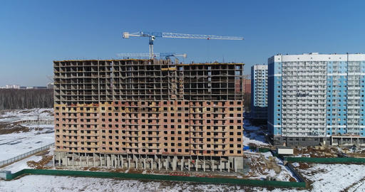 Multi-storey building under construction and building cranes Footage