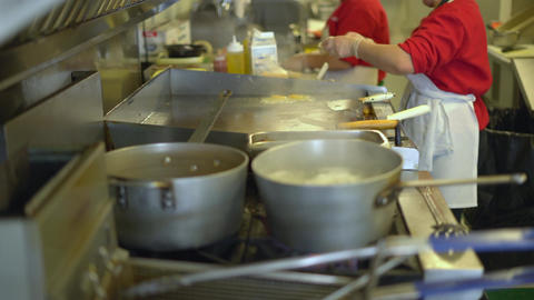Short order cooks in a busy deli Footage