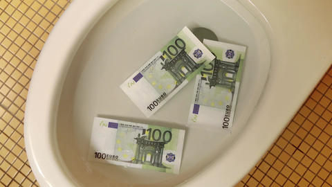 Video of flushing euro banknotes in toilet bowl in 4K Live Action