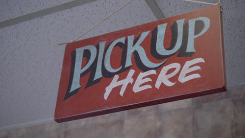 Pick up order here sign in deli Footage