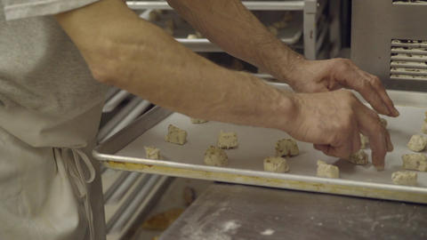 Italian baker prepares cookie dough on tray Footage