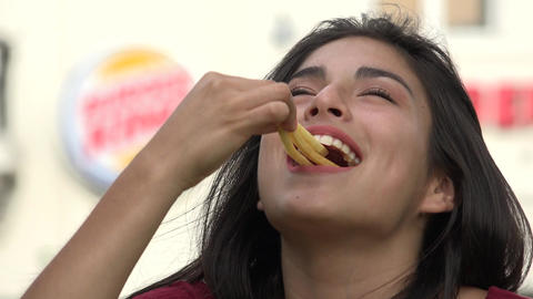 Girl Eating Junk Food And French Fries Footage