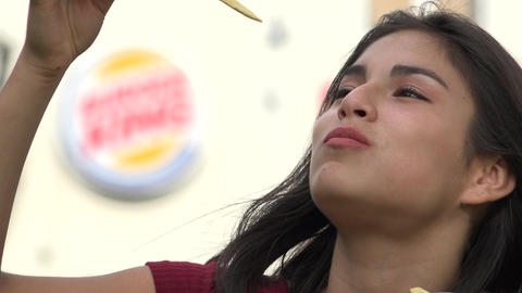 Teen Girl Eating French Fries Footage