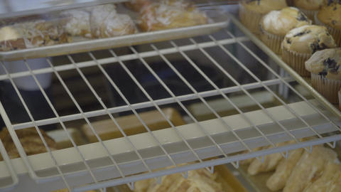 Pastries and croissants are put into case Footage