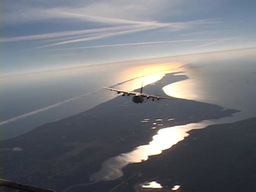 Lockheed AC-130 hercules gunship in flight firing its gun Footage