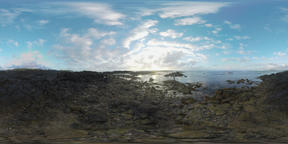 360 VR Ocean coast with rocks and man flying copter Archivo