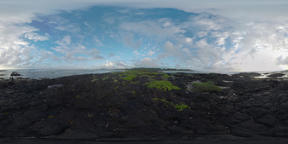360 VR Mauritius rocky coast of the ocean and man controlling flying copter Archivo