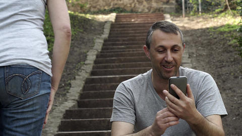 Man In Video Call Outdoor On Stairs Person Walks By Footage
