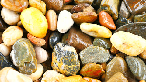 Wet stony pavement from natural pebbles. Colorful rounded stones, traditional bu Footage