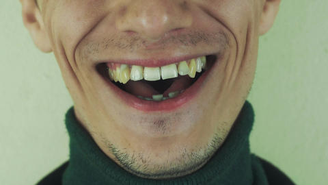 Adult man pronounce words in front camera. Mouth. Teeth. Bristle. Play the ape Live Action