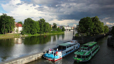 Tourist boat floating on the Vltava river before storm Footage