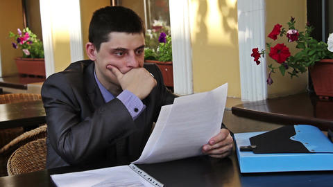 Businessman works with documents at the table Footage