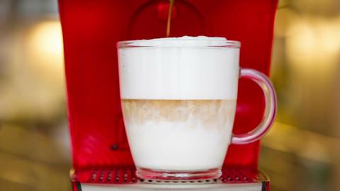 closeup of latte macchiato preparation