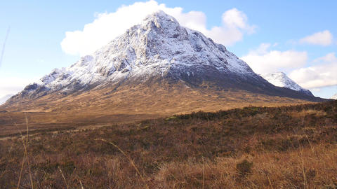 Sunny winter day on meadow at river Coupall at delta to river Etive. Snowy cone  영상물