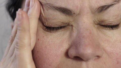 Closeup of Woman Massaging Her Headache Pain Footage