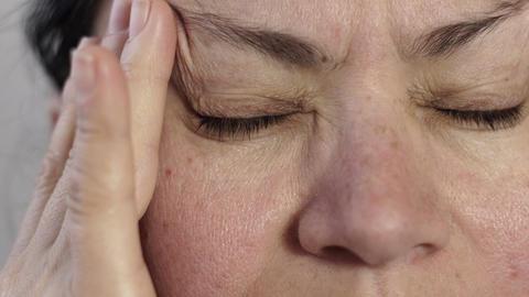 Closeup of Woman Massaging Her Headache Pain Footage