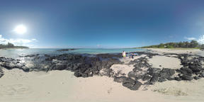 360 VR View to the ocean, beach and family walking among black rocks. Mauritius  Footage
