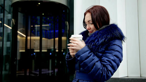 Young woman hands warm cup of coffee in the winter Footage