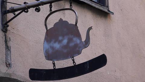 The emblem, a sign above the entrance to the restaurant in Stockholm. Sweden. 4K Footage