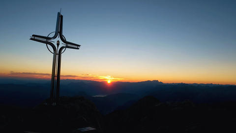 Time lapse of Alps daybreak. Iron cross at mountain top... Stock Video Footage