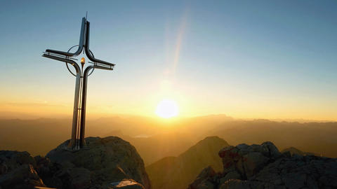 Time lapse of Alps daybreak. Iron cross at mountain top in alp. Cross on top of  Live Action