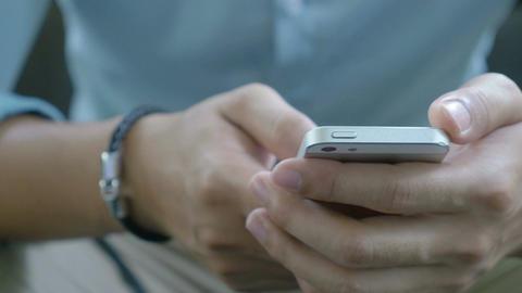 4K : Close up hands of Business Asian man using smartphone, Pan shot Live Action
