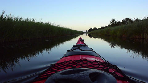Kayaking on a canal in nature ビデオ