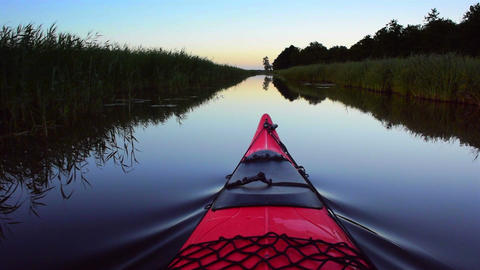 Kayaking on a canal in nature Live Action
