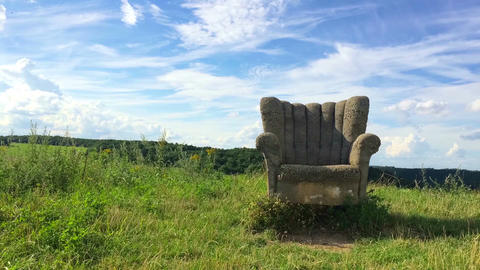 Abandoned concrete chair on the hill at sunset Footage