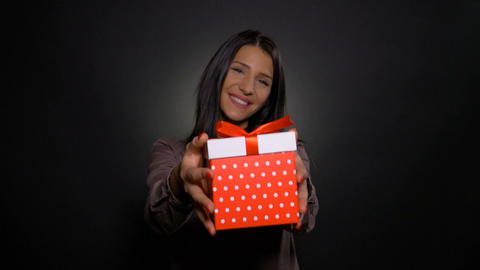 Happy beautiful woman holding and showing a birthday gift box present Footage