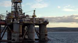 Great Britain Scotland Highland Invergordon ship drive past oil platform Footage
