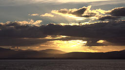 Great Britain Scotland Highland Invergordon sunset with gold shining clouds