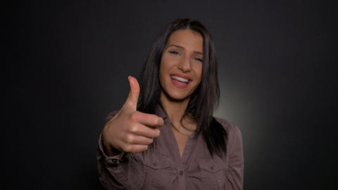 Happy woman making success ok thumb up gesture Footage