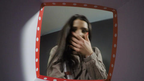 POV of expressive woman gets surprised when opening a gift box Footage