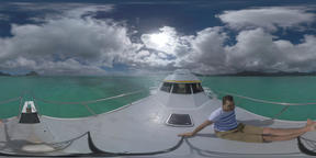 360 VR Man traveling by yacht sailing to Mauritius Island