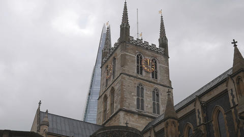 Ancient church and modern skyscraper Footage