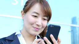 Businesswoman touching on cellphone at street Live Action
