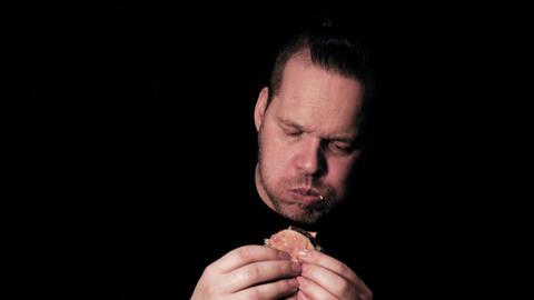 Hungry man eating big hamburger junk food Live Action