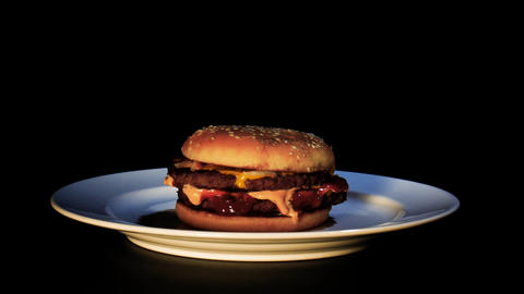 Rotating hamburger on a dinner plate Live Action