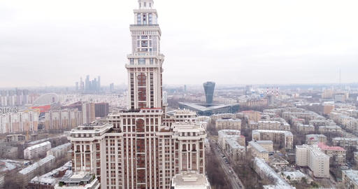 Flight from the park to a high-rise apartment house with a spire Footage