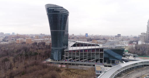 Modern high-rise building and football stadium Footage