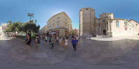 360 VR View to the street with people and Valencia Cathedral Footage