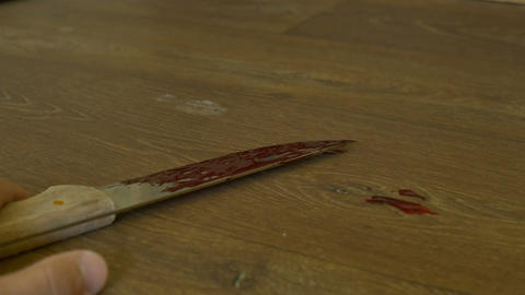 Bloody Knife in Man Hand Filmmaterial