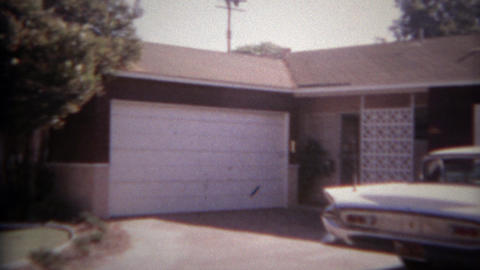 1965: White classic car parked in driveway of modest suburban home. SAN DIEGO, C Footage